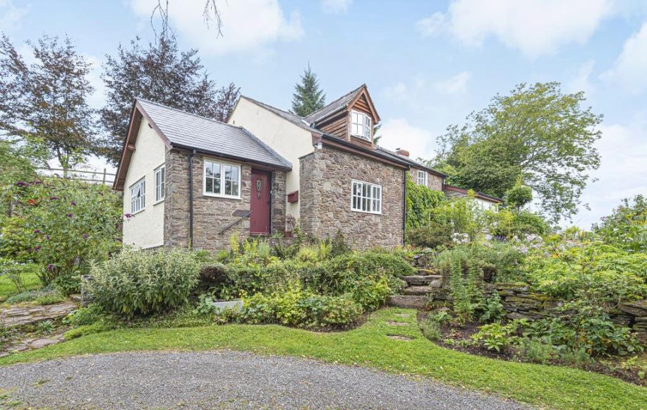 Surrounded by colourful gardens, caringly tended