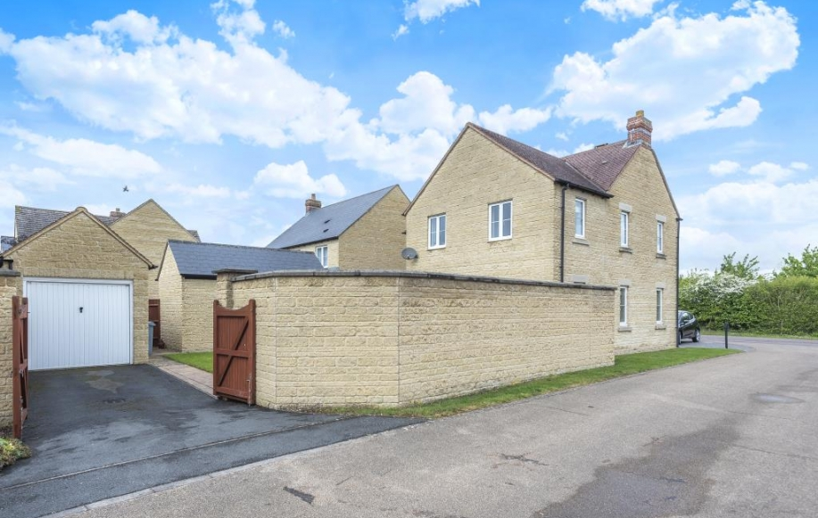 Rear Aspect with Garage & Driveway