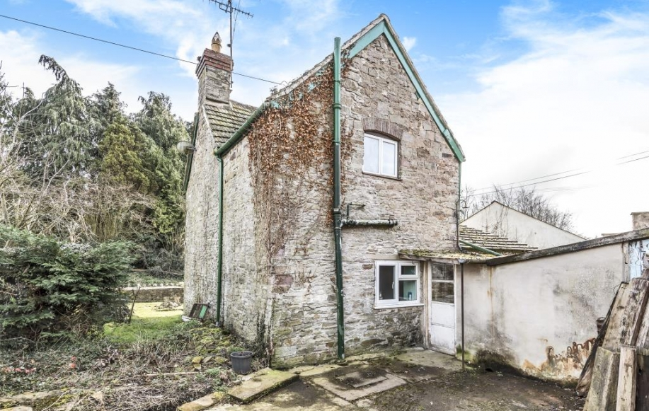 Rear with garage and outbuildings/workshop