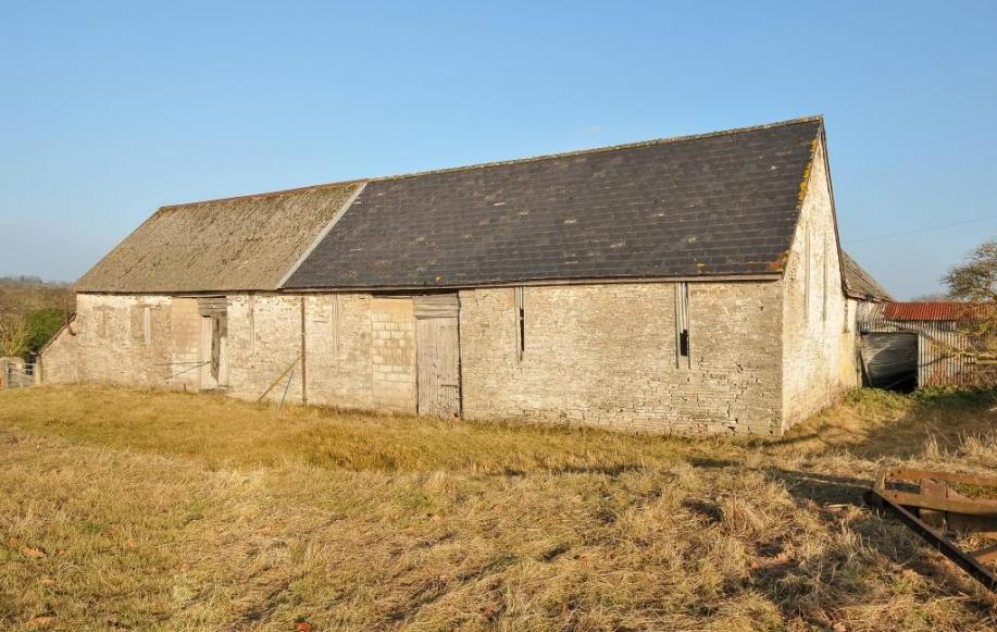 Stone barns adjoining countryside