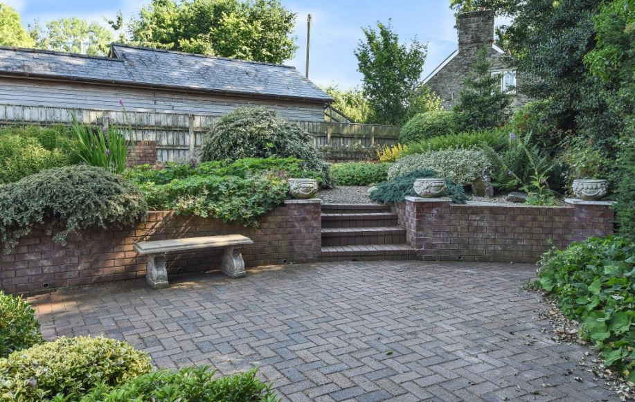 Rear gardens with terrace and shrubs and bushes