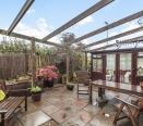 Private partly covered patio garden