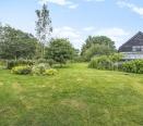 Large mature gardens adjoining farmland