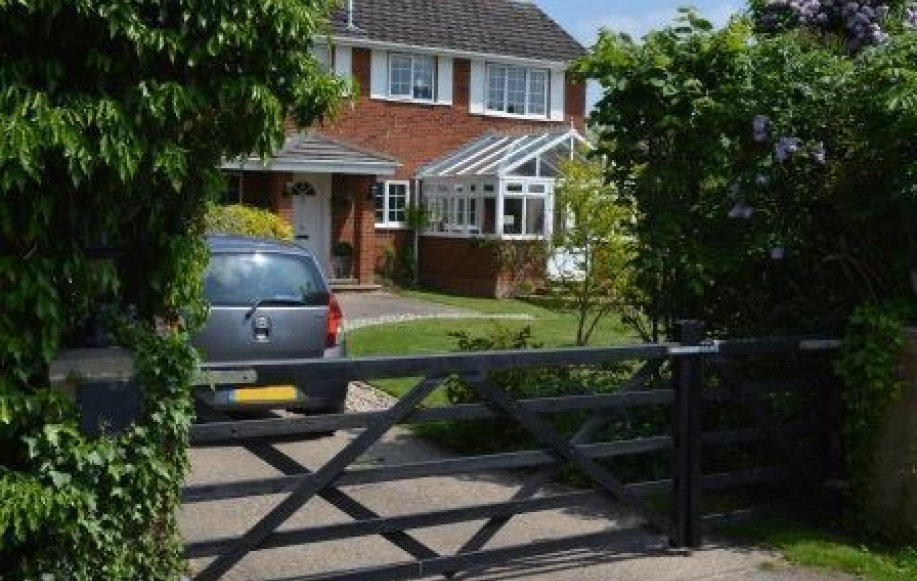 Front Garden With Gated Driveway