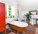 Period style bathroom with roll top bath