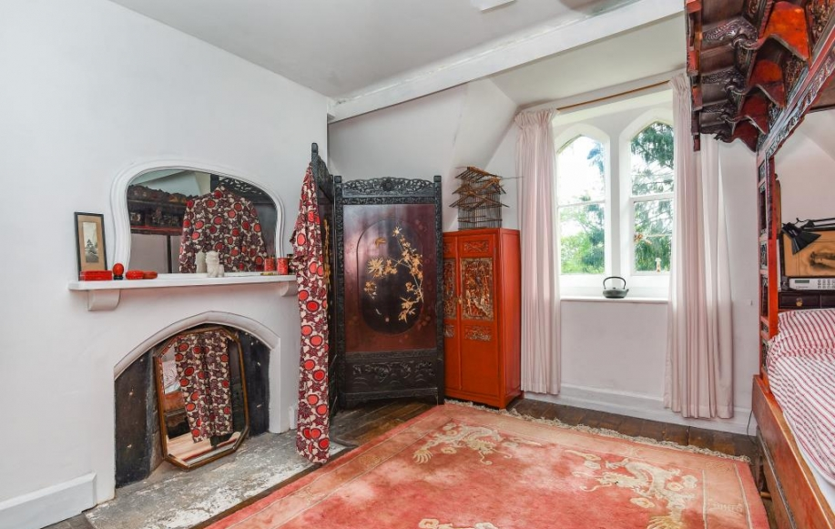 Bedroom with period fireplace