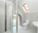 Lovely Bathroom with feature arched window