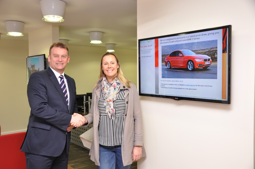 The winner, Libby Shuttle, with Paul Bosanko, Chancellors' Area Sales Manager, who conducted the market appraisal on Libby's property.