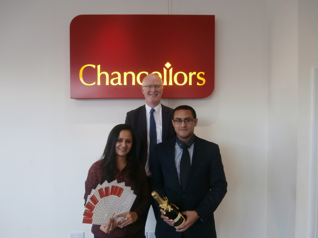 The winner, Mrs Sood, with Nic Simmonds (Area Manager) and (front right) Ian Thomas, Lettings Manager of the Chancellors High Wycombe office.